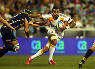 Liam Messam fends Mark Chisholm.Super 14 rugby union match, Brumbies v Cheifs, Canberra, Australia. Saturday 19 February 2011. Photo: Paul Seiser/PHOTOSPORT.../SPORTZPICS