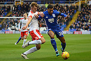 Barnsley defender James Bree (2)  makes a tackle on Birmingham City midfielder David Davis (26) 0-0 during the EFL Sky Bet Championship match between Birmingham City and Barnsley at St Andrews, Birmingham, England on 3 December 2016. Photo by Alan Franklin.