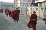 Myanmar Shan state Keng Tung AKA Chiang Tung Priests coming to collect food donations