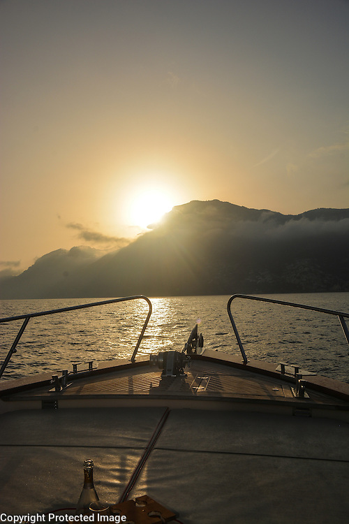 View of the Amalfi Coast at sunset, as seen from the Tyrrhenian Sea