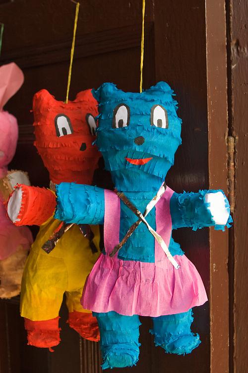 Pinata dolls for sale in a store in Granada, Nicaragua.