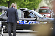 Cleveland District 1 police commander Thomas McCartney, left, prepares for the arrival of Amanda Berry at the home of her sister on Wednesday, May 8, 2013, in Cleveland, Ohio..Amanda Berry, Michelle Knight and Gina DeJesus were held captive by Ariel Castro for years in a house on Seymour Avenue. © David Richard