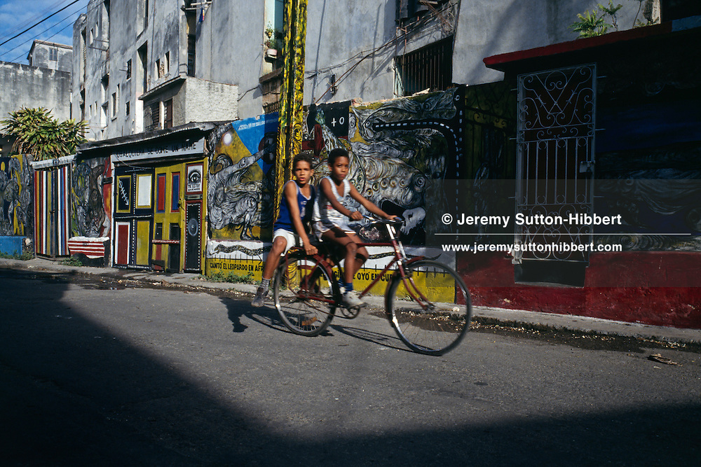 Young children on bicycle, Havana, Cuba.  1993.