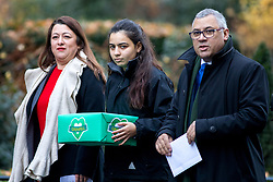 © Licensed to London News Pictures. 12/12/2017. London, UK. Former residents of Grenfell Tower Sandra Ruiz, a girl who does not want to be named and Nicholas Burton hand a petition in at Downing Street, calling for the public inquiry into the disaster to be overhauled. This includes having a panel from a diverse range of backgrounds installed alongside Sir Martin Moore-Bick, the retired Court of Appeal judge leading the process. Photo credit : Tom Nicholson/LNP
