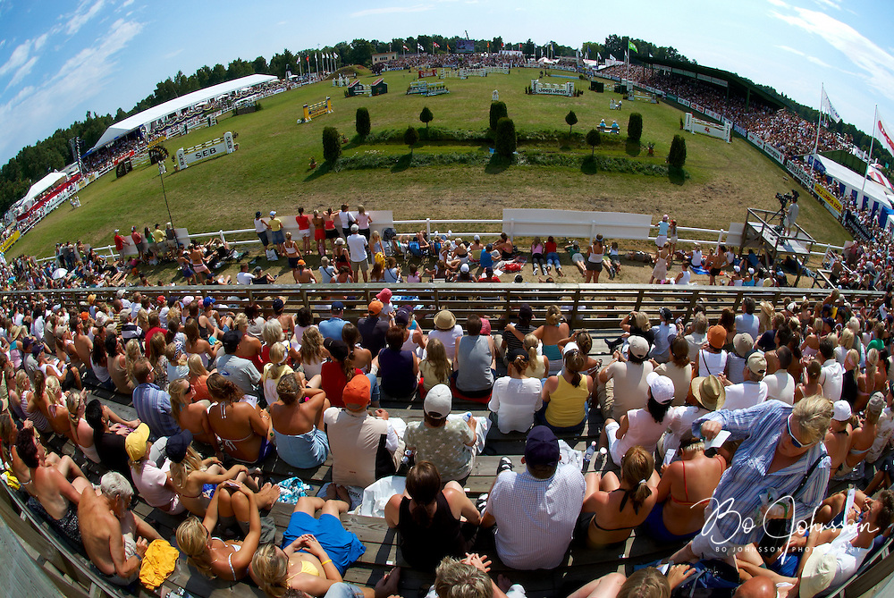 The SEB Grand Prix on the last day of Falsterbo Horse Show.<br /> Horse Trials have since the 1920s proud traditions on the Falsterbo Peninsula in southwestern Sweden, nowadays run as the international meeting Falsterbo Horse Show.<br /> In 2007 685 horses from 15 countries competed during the seven days of the meeting.<br /> July 2005.<br /> Only for editorial use.
