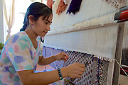 Uzbekistan, Samarqand.<br /> Silk carpet manufacture.