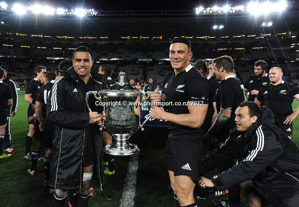 Liam Messam and Sonny Bill Williams as Israel Dagg looks on with the Bledisloe Cup at the conclusion of the Rugby Championship and Bledisloe Cup Rugby Union test match, New Zealand All Blacks versus Australian Wallabies at Eden Park, Auckland, New Zealand. Saturday 25 August 2012.  Photo: Andrew Cornaga/Photosport.co.nz