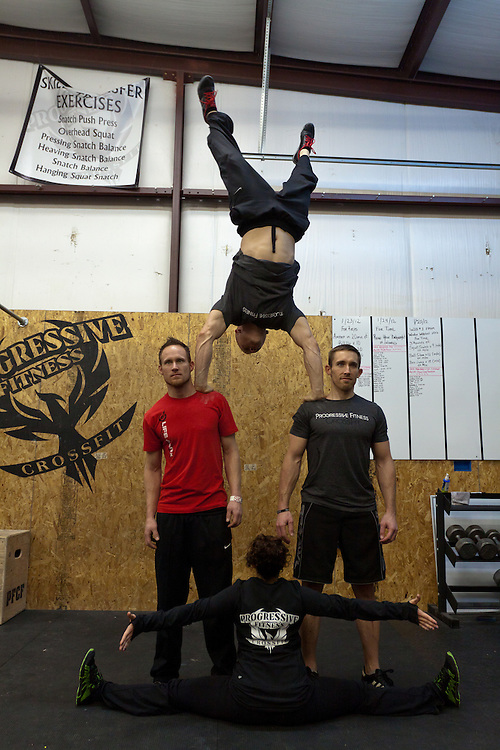 Cody Jamison does a handstand goofing off at Progressive Fitness CrossFit. Crossfit image, picture, photo, photography of health, elite, exercise, training, workouts, WODs, taken at Progressive Fitness CrossFit,Colorado Springs, Colorado, USA.