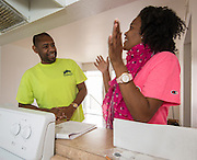 Ellis Gray, left, goes over curriculum with Home Instruction for Parents of Pre-K Youth (HIPPY) instructor Eliana Hebrew, right, at his home in Pasadena, March 11, 2014.