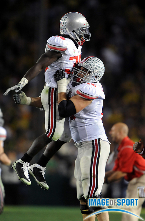 Jan 1, 2010; Pasadena, CA, USA; Ohio State Buckeyes linebacker Brian Rolle (36) and offensive lineman J.B. Shuggarts (76) in the fourth quarter of the 2010 Rose Bowl against the Oregon Ducks at the Rose Bowl. Ohio State defeated Oregon 26-17.