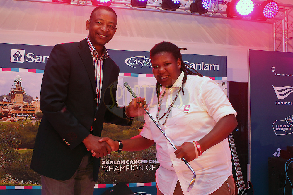 Temba Mvusi Chief Executive Market Development Sanlam presents Yolanda Duma with the 3rd place prize in the women's A division during the prize giving and gala dinner of the Sanlam Cancer Challenge Finals held at The Lost City Golf Course in Sun City near Johannesburg on the 22nd October 2013<br /> <br /> Photo by Ron Gaunt - SPORTZPICS