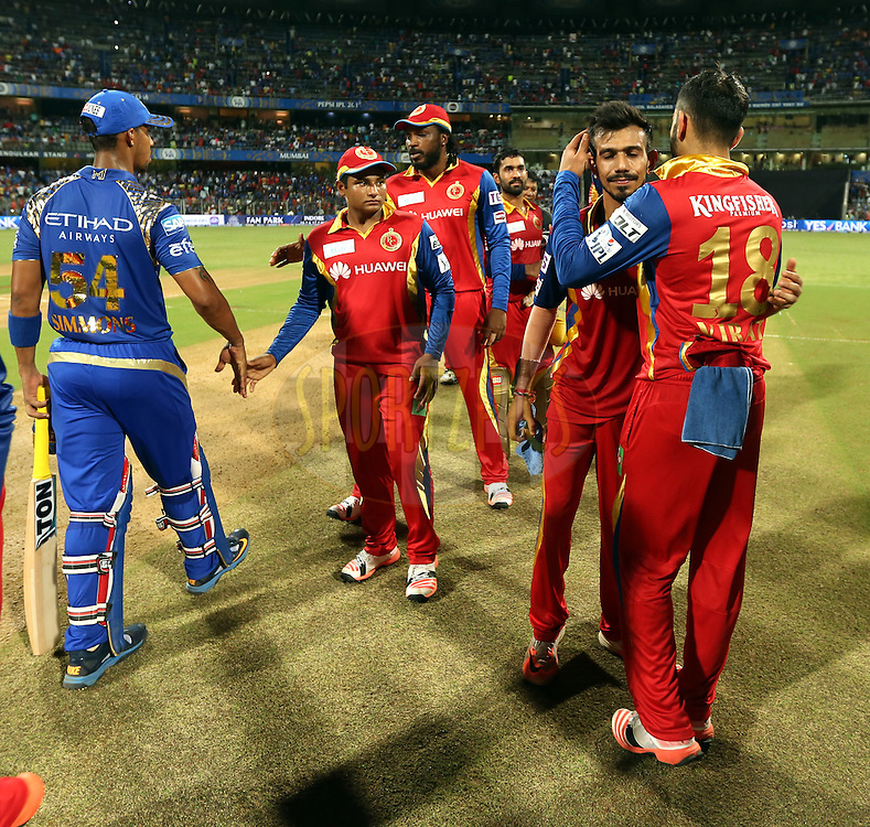 Mumbai Indians players and Royal Challengers Bangalore players shakes hand after the  match 46 of the Pepsi IPL 2015 (Indian Premier League) between The Mumbai Indians and The Royal Challengers Bangalore held at the Wankhede Stadium in Mumbai, India on the 10th May 2015.<br /> <br /> Photo by:  Sandeep Shetty / SPORTZPICS / IPL