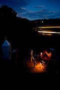 Oliveira_MG, Brazil.<br /> <br /> Ailton Carlos de Jesus, caminhoneiro. No altar em homenagem ao seu filho Alex, tambem caminhoneiro, morto em acidente na entrada de Oliveira, Minas Gerais.<br /> <br /> Ailton Carlos de Jesus, trucker. On the altar in honor of his son Alex, He was truck driver and He died in an accident in Oliveira, Minas Gerais.<br /> <br /> Foto: LEO DRUMOND / NITRO