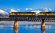 Winter scenic of the Alaska Railroad crossing the bridge over Twentymile River, Turnagain Arm.
