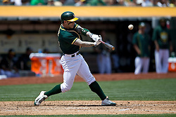 OAKLAND, CA - JULY 23:  Brett Lawrie #15 of the Oakland Athletics at bat against the Toronto Blue Jays during the fourth inning at O.co Coliseum on July 23, 2015 in Oakland, California. The Toronto Blue Jays defeated the Oakland Athletics 5-2. (Photo by Jason O. Watson/Getty Images) *** Local Caption *** Brett Lawrie