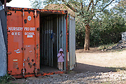A pupil stands at the entrance of MADICAA school (makadara division campaign against aids) in Makadara, Kenya. The Pre-primary/nursery school was started in 2006, the school building is a modified shipping container.