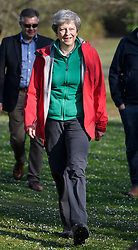 © Licensed to London News Pictures. 19/04/2019. Maidenhead, UK. Prime THERESA MAY and her husband PHILIP MAY help out at the Maidenhead Easter 10 run in her constituency of Maidenhead in Berkshire. Parliament currently on Easter recess after an extension to Article 50 was granted by the EU. Photo credit: Ben Cawthra/LNP