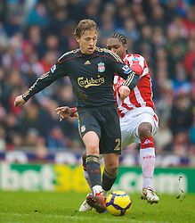 STOKE, ENGLAND - Saturday, January 16, 2010: Liverpool's Lucas Leiva and Stoke City's Salif Diao during the Premiership match at the Britannia Stadium. (Photo by David Rawcliffe/Propaganda)