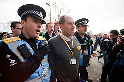Liberal Democrat party conference delegate Patrick Streeter is escorted away from Devonshire Green followed by press and demonstrators after attempting to gate crash the Demo's start and address the demonstrators at Devonshire Green Sheffield Sheffield city Hall where the Liberal Democrats are holding their Party conference Sheffield Saturday 12 March 2011.Images © Paul David Drabble