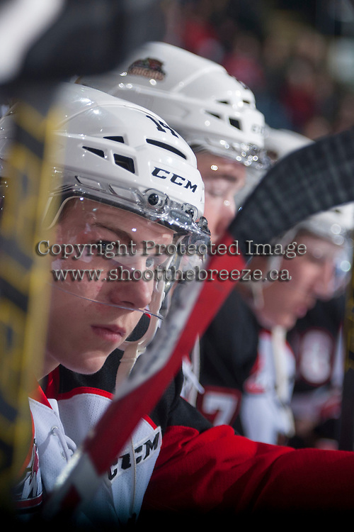 KELOWNA, CANADA - DECEMBER 5: Colby McAuley #14 of Prince George Cougars sits on the bench against the Kelowna Rockets on December 5, 2014 at Prospera Place in Kelowna, British Columbia, Canada.  (Photo by Marissa Baecker/Shoot the Breeze)  *** Local Caption *** Colby McAuley;