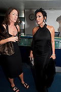 SALLY ANN LASSON; NANCY DELL D'OLIO, GQ Man of the Year awards. The royal Opera House. Covent Garden. London. 6 September 2011. <br /> <br />  , -DO NOT ARCHIVE-© Copyright Photograph by Dafydd Jones. 248 Clapham Rd. London SW9 0PZ. Tel 0207 820 0771. www.dafjones.com.