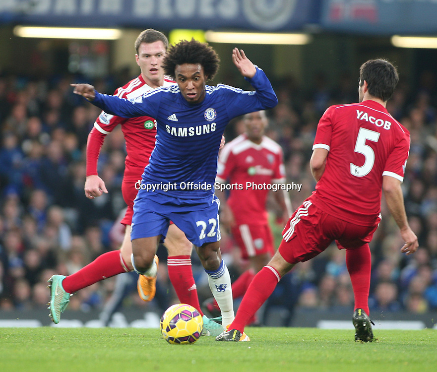 22 November 2014 - Barclays Premier League - Chelsea v West Bromwich Albion - Willian of Chelsea evades a tackle.<br /> <br /> <br /> Photo: Ryan Smyth/Offside