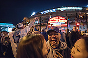 Fans celebrate outside Wrigley Field after the Chicago Cubs defeat the LA Dodgers to win their first pennant since 1945.