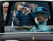 © Licensed to London News Pictures. 19/05/2012. WIndsor, UK HRH Queen Elizabeth II is driven to the muster. Armed Forces muster and parade in Windsor today , 19th May 2012, in tribute to Her Majesty the Queen for the Diamond Jubilee. 2,500 troops paraded through the town before the Queen and Duke of Edinburgh to mark the Diamond Jubilee. Once the parade has passed the Queen and Duke traveled along the same route to an arena within Home Park, where the troops mustered. A tri-service flypast of 78 aircraft, including helicopters, Hawks, the Battle of Britain Memorial Flight, the Red Arrows and Tornados went overhead. Photo credit : Stephen Simpson/LNP
