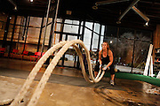 Kaycie Brelo, 30, slaps ropes at the Psycho Gym in Dallas, Texas, on December 20, 2012.  Brelo works out five times a week at the Psycho Gym and is four months pregnant.  (Stan Olszewski/The Dallas Morning News)
