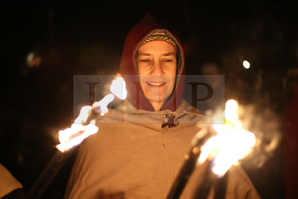 © Licensed to London News Pictures. 20/02/2016. York, UK. A viking woman is lit by a burning torch during the finale of the annual Jorvik Viking Festival in York, North Yorkshire. The historic city was transformed into a fiery battleground as this year's end to the week long festival told the story of the infamous Battle of Assundun. The festival, which is run by the Jorvik Viking Centre, takes place every February in tradition of an ancient Viking festival known as Jolablot.  Photo credit : Ian Hinchliffe/LNP