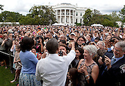 05.JUNE.2012. WASHINGTON D.C.<br /> <br /> PRESIDENT BARACK OBAMA AND FIRST LADY MICHELLE OBAMA SHAKE HANDS WITH GUESTS DURING AN EVENT ON THE SOUTH LAWN FOR POLITICAL APPOINTEES, JUNE 5, 2012.  <br /> <br /> BYLINE: EDBIMAGEARCHIVE.CO.UK<br /> <br /> *THIS IMAGE IS STRICTLY FOR UK NEWSPAPERS AND MAGAZINES ONLY*<br /> *FOR WORLD WIDE SALES AND WEB USE PLEASE CONTACT EDBIMAGEARCHIVE - 0208 954 5968*
