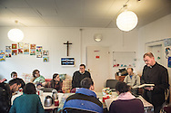 The Rev. Markus Fischer, pastor of the Evangelisch-Lutherische St. Trinitatisgemeinde, a SELK Lutheran church in Leipzig, Germany, leads a Bible study for Iranian and other refugees on Friday, Nov. 13, 2015, near the church in Leipzig. Joining the refugees are LCMS Missionary Deaconess Elizabeth Ahlman (seated on couch, second from left), and the Rev. James Krikava, OIM regional director for Eurasia.  LCMS Communications/Erik M. Lunsford