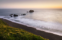 Twilight view of surf and beaches, from rugged cliffs and bluffs of Sonoma Coast State Park, California