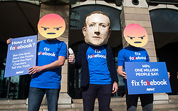 April 26, 2018 - London, London, United Kingdom - Two Emojis and a giant Mark Zuckerberg Head call on MPs to Fix Facebook ahead of the Parliamentary hearing with Facebook Chief Technological Officer, Mike Schroepfer into allegations of Fake News..One Million people are calling on MPs to Fix the Fake accounts and fake facts. (Credit Image: © Mark Thomas/i-Images via ZUMA Press)
