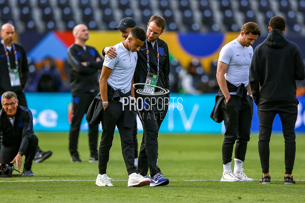 England Head Coach Gareth Southgate with a supporting arm around the shoulder of England midfielder Jesse Lingard (Manchester United) during the England walk around the pitch ahead of the Nations League Semi-Final against Holland at Estadio D. Afonso Henriques, Guimaraes, Portugal on 5 June 2019.