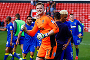 AFC Wimbledon goalkeeper George Long (1), on loan from Sheffield United, celebrates the last minuted victory during the EFL Sky Bet League 1 match between Walsall and AFC Wimbledon at the Banks's Stadium, Walsall, England on 14 April 2018. Picture by Simon Davies.