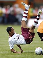 Photo: Jonathan Butler.<br /> Barnet v Arsenal. Pre Season Friendly. 14/07/2007.<br /> Theo Walcott of Arsenal takes a tumble.