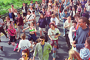 Ravers dancing and marching through the streets of London during the first Criminal Justice March. Park Lane, London, UK, 1st of May 1994.