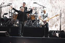 © Licensed to London News Pictures. 10/07/2017. Twickenham Stadium, London, UK. U2 perform during their Joshua Tree Tour 2017. Band members include Bono, The Edge, Adam Clayton, Larry Mullen Jr.  Photo credit: Andy Sturmey/LNP