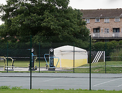 © Licensed to London News Pictures. 18/08/2011. A police forensics tent in Ponders End Recreation Ground in Enfield, London today (18/08/2011) where a 14 Year-old boy was found stabbed to death yesterday afternoon. Photo credit: Ben Cawthra/LNP
