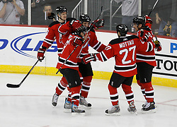 Mar 17, 2009; Newark, NJ, USA; The New Jersey Devils celebrate a goal by New Jersey Devils right wing Jamie Langenbrunner (15) during the first period at the Prudential Center.