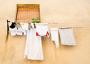 Laundry hangs outside of a window in a small town in Italy.