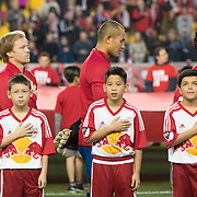 Mar 19, 2016; Harrison, NJ, USA; New York Red Bull players stand with fans during the national anthem at Red Bull Arena. Red Bulls defeat the Dynamo 4-3. Mandatory Credit: William Hauser-USA TODAY Sports