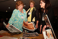 (from left) Fran Walker (member of chorus 1957 - 1965,) shows Dolores (Rehling) Kulhanek (member 1959 - 1967) and Wright State University archivist Toni Vanden Bos pictures that she'll be donating to the WSU archives during a reunion of the Inland Children's Chorus at MCL Restaurant & Bakery in Kettering, Saturday, April 27, 2013.  Inland Manufacturing, a division of General Motors from its creation in 1922 to 1989, sponsored the Inland Children's Chorus from 1936 to 1970.