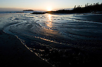 Chesterman Beach, near Tofino, BC Canada, approximately 3 kilometers of white sand and scattered rock outcroppings, is peaceful at winter sunset.