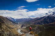 A hiker absorbs the view of the Marsyangdi River Valley in the Himilayas.<br /> Annapurna Trek, Utah