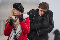 © Licensed to London News Pictures. 27/02/2018. London, UK. Members of the public wade through snowfall on the Millennium Bridge near St Paul's Cathedral in the City of London, as a cold front, named the 'Beast From the East' hits the capital. Amber weather warnings are in place for large parts of the east of the UK as a severe cold front heads in from Russia. Photo credit: Ben Cawthra/LNP