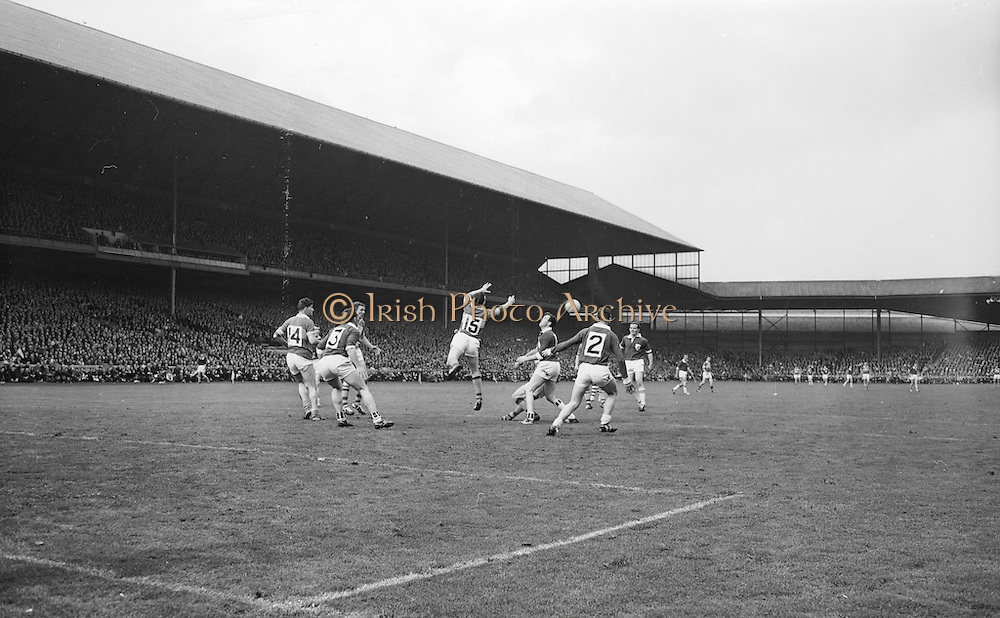 Kerry's J.J. Barrett punches ball to team mate during the All Ireland Senior Gaelic Football Final Kerry v. Galway in Croke Park on the 26th September 1965. Galway 0-12 Kerry 0-09.<br />