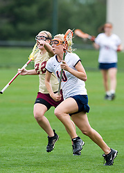 Virginia A Kaitlin Duff (10) runs past Boston College's Catharine Saylor (22).  The #4 ranked Virginia Cavaliers women's lacrosse team defeated the Boston College Eagles 12-4 at the University of Virginia's Klockner Stadium in Charlottesville, VA on April 5,2008.