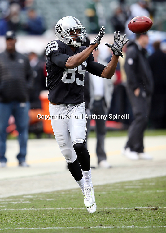 Oakland Raiders wide receiver Amari Cooper (89) catches a pass while warming up before the 2015 week 15 regular season NFL football game against the Green Bay Packers on Sunday, Dec. 20, 2015 in Oakland, Calif. The Packers won the game 30-20. (©Paul Anthony Spinelli)